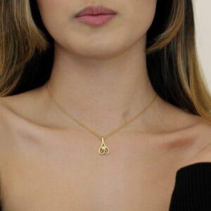friederike grace 18k yellow gold diamond upturned heart necklace designyard contemporary jewellery gallery dublin ireland handmade irish jewelry jewellery jewelery celtic