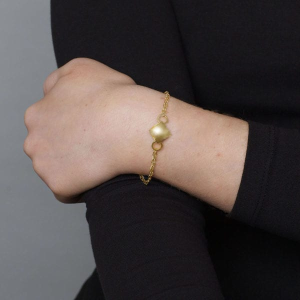sterling silver gold plated small pillow on double trace chain bracelet designyard.