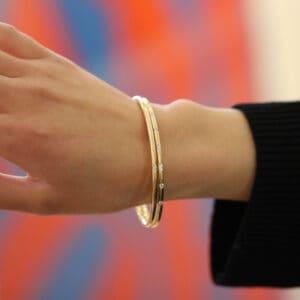9k yellow gold solid oval round nine diamond bangle designyard goldsmiths workshop contemporary jewellery gallery dublin ireland handamde jewelry jewellers shop designer design