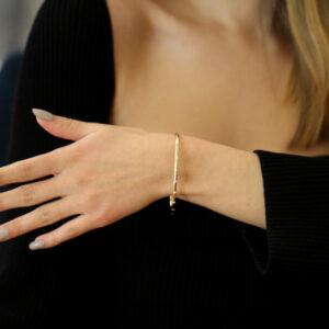 9k yellow gold solid oval round nine diamond bangle designyard goldsmiths workshop contemporary jewellery gallery dublin ireland