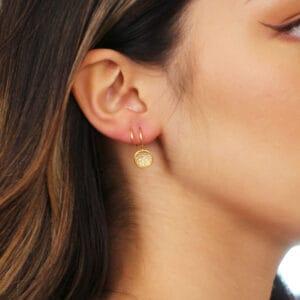 josephine bergsoe yellow gold diatom swirl diamond earrings designyard contemporary jewellery gallery dublin ireland fine jewelry design