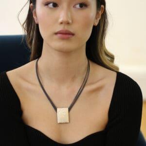 ursula muller black reversible black champagne aluminium necklace designyard contemporary jewellery gallery dublin ireland luxe jewelry