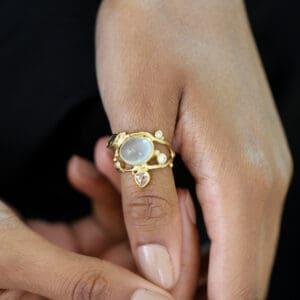 josephine bergsoe 18k 22k yellow gold aquamarine diamond sapphire seafire double ring designyard contemporary jewellery gallery dublin ireland handmade alternative engagement ring design designer jewellers jewelry irish shop