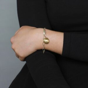 Domed charm bracelet by Kate Smith at Designyard contemporary jewellery gallery Dublin Ireland