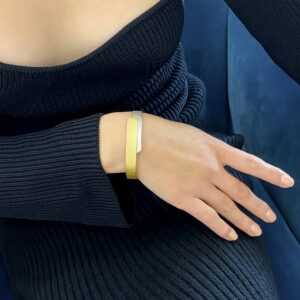 silver and  22k yellow gold hinged by manu at designyard contemporary jewellery gallery dublin ireland