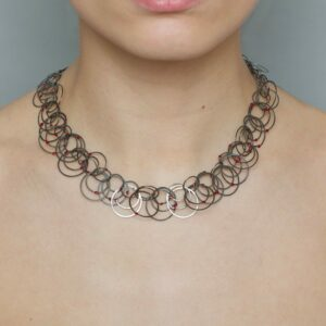 Steel red dot necklace by erik urbschat at designyard contemporary jewellery gallery dublin ireland