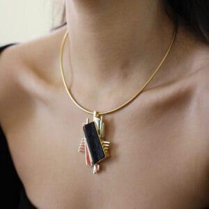 18k gold and black onyx art pendant by rudolf heltzel at designyard contemporary jewellery gallery dublin ireland
