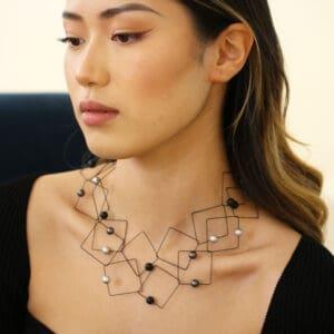 Geometric aluminium bead sautoir by ursula muller at designyard contemproary jewellery gallery dublin ireland