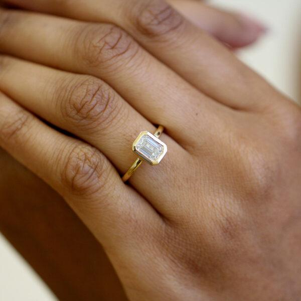 ronan campbell 18k yellow gold mēdēəm bezəl emerald diamond engagement ring handmade jewelry design designer irish jewellers shop